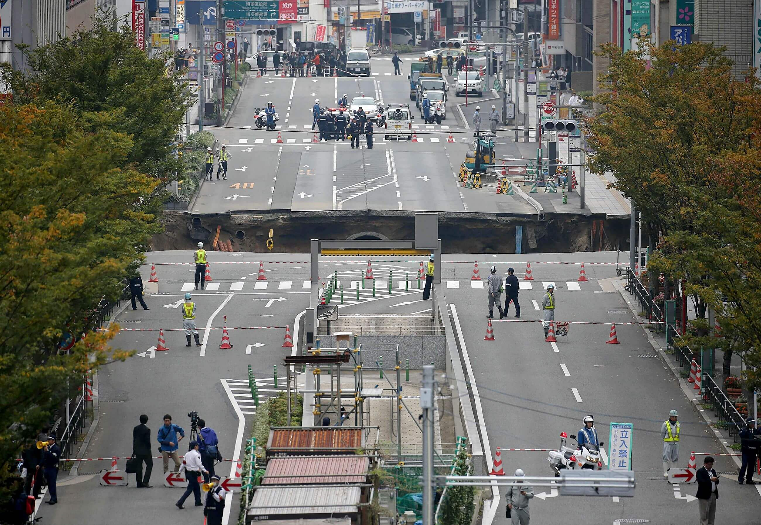 Giant sinkhole swallows Japan city street