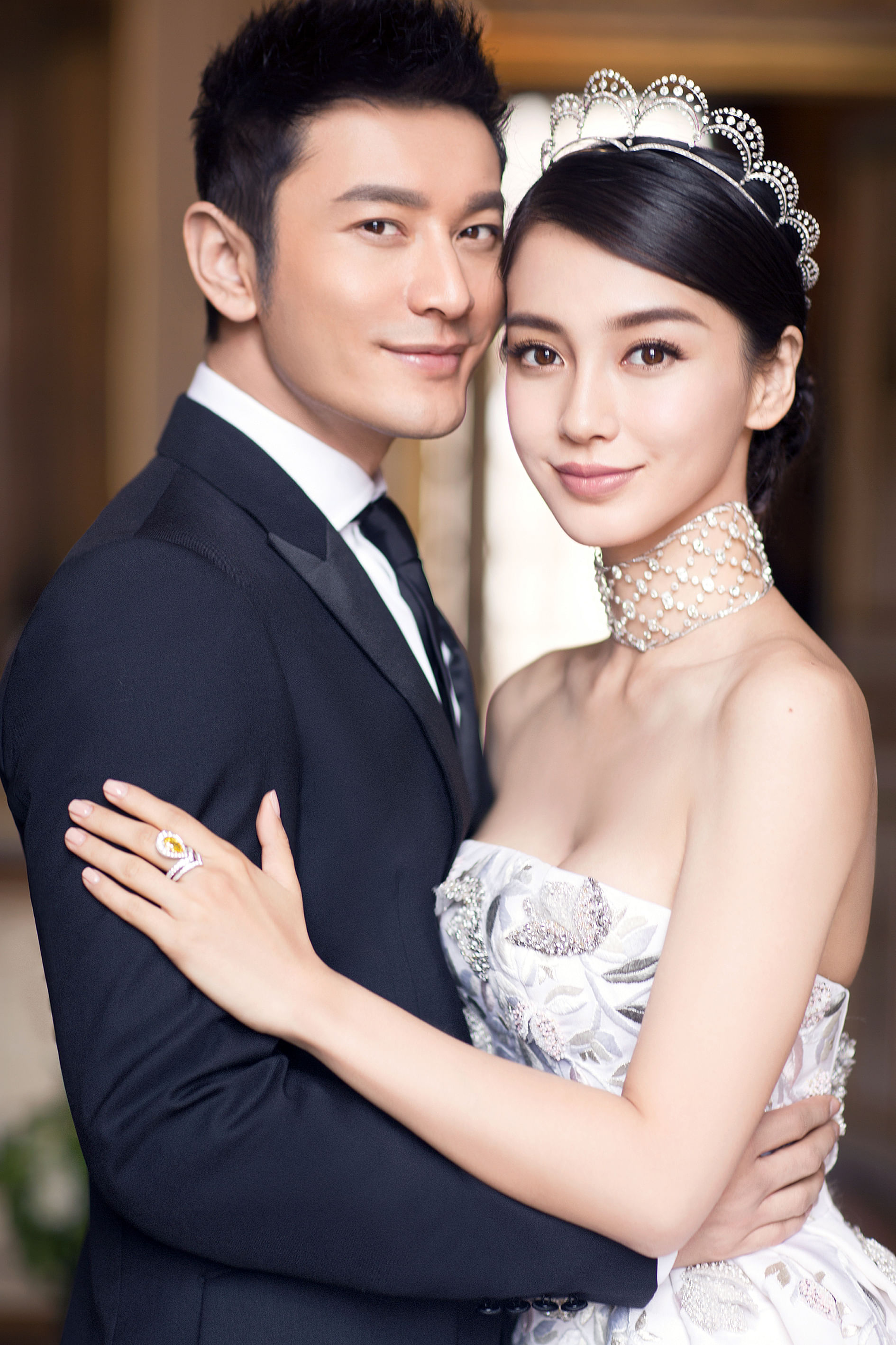 Actors Huang Xiaoming and Angelababy hold fairy-tale like