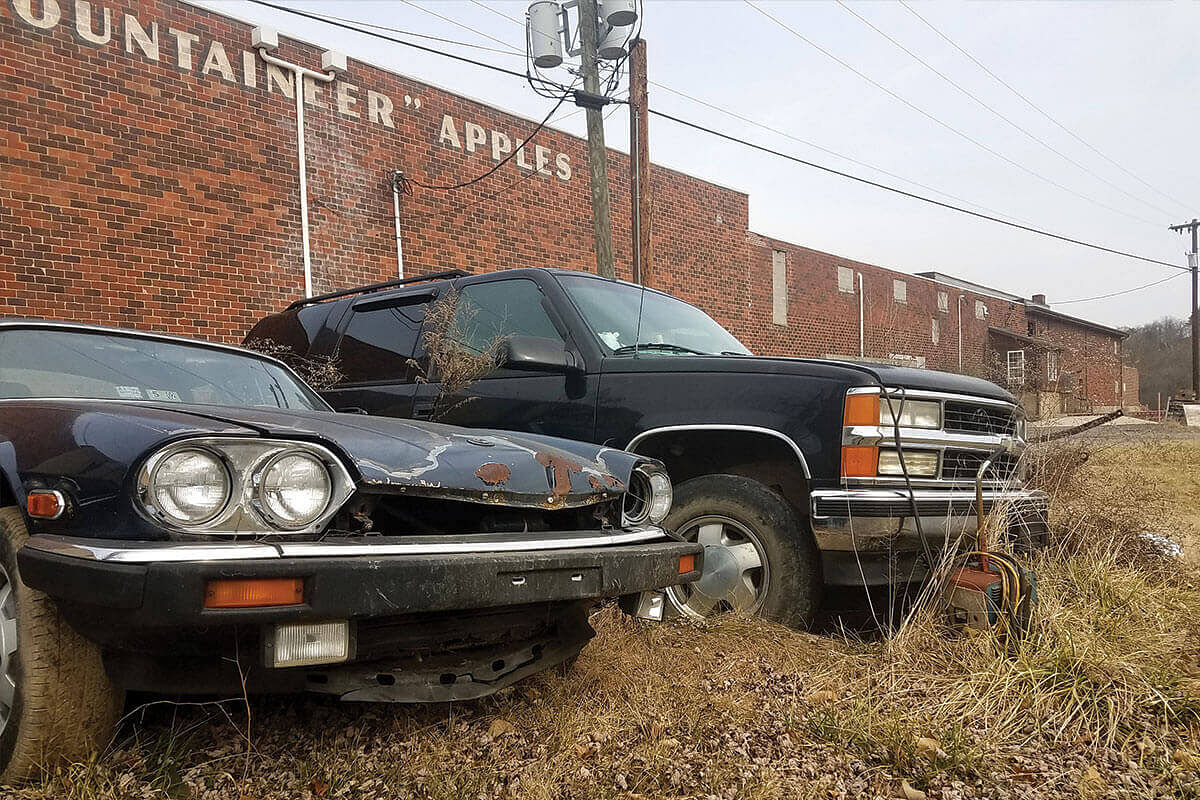 Rusted cars outside an abandoned fruit processing plant in Paw Paw, West Virginia in the United States.