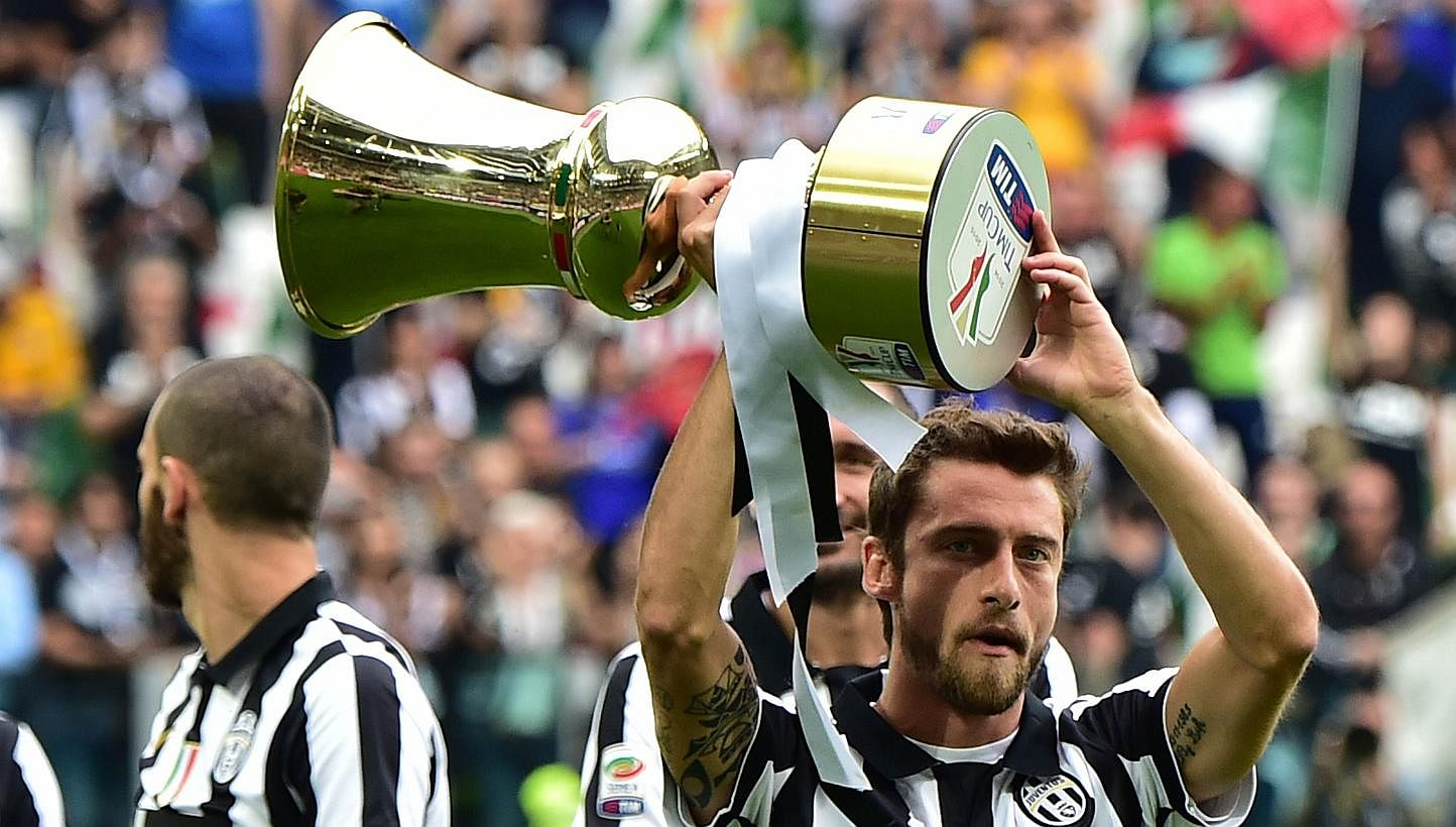 Image result for Claudio Marchisio with trophy coppa italia