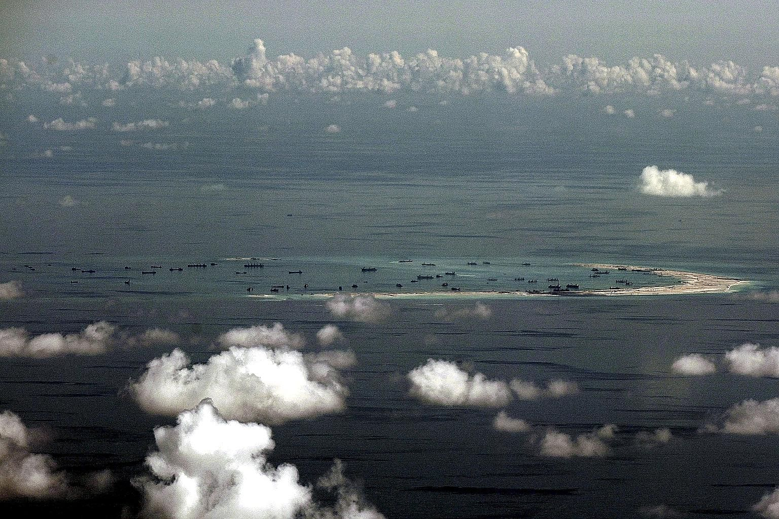 """An aerial photo showing China's alleged land reclamation on Mischief Reef in the South China Sea, west of Palawan in the Philippines. Several """"known unknowns"""" could affect the South China Sea situation in the foreseeable future."""