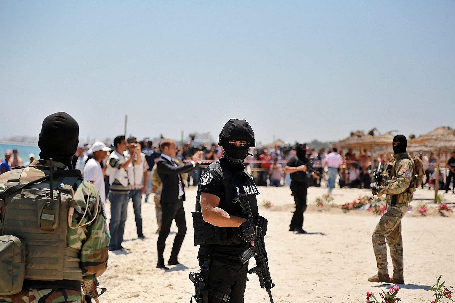Tunisian security forces at a wreath-laying ceremony on Monday for victims of the shooting at a beach resort in Sousse, near Tunis. Addressing the root causes of extremism might help persuade those susceptible to radicalisation that they have a stake