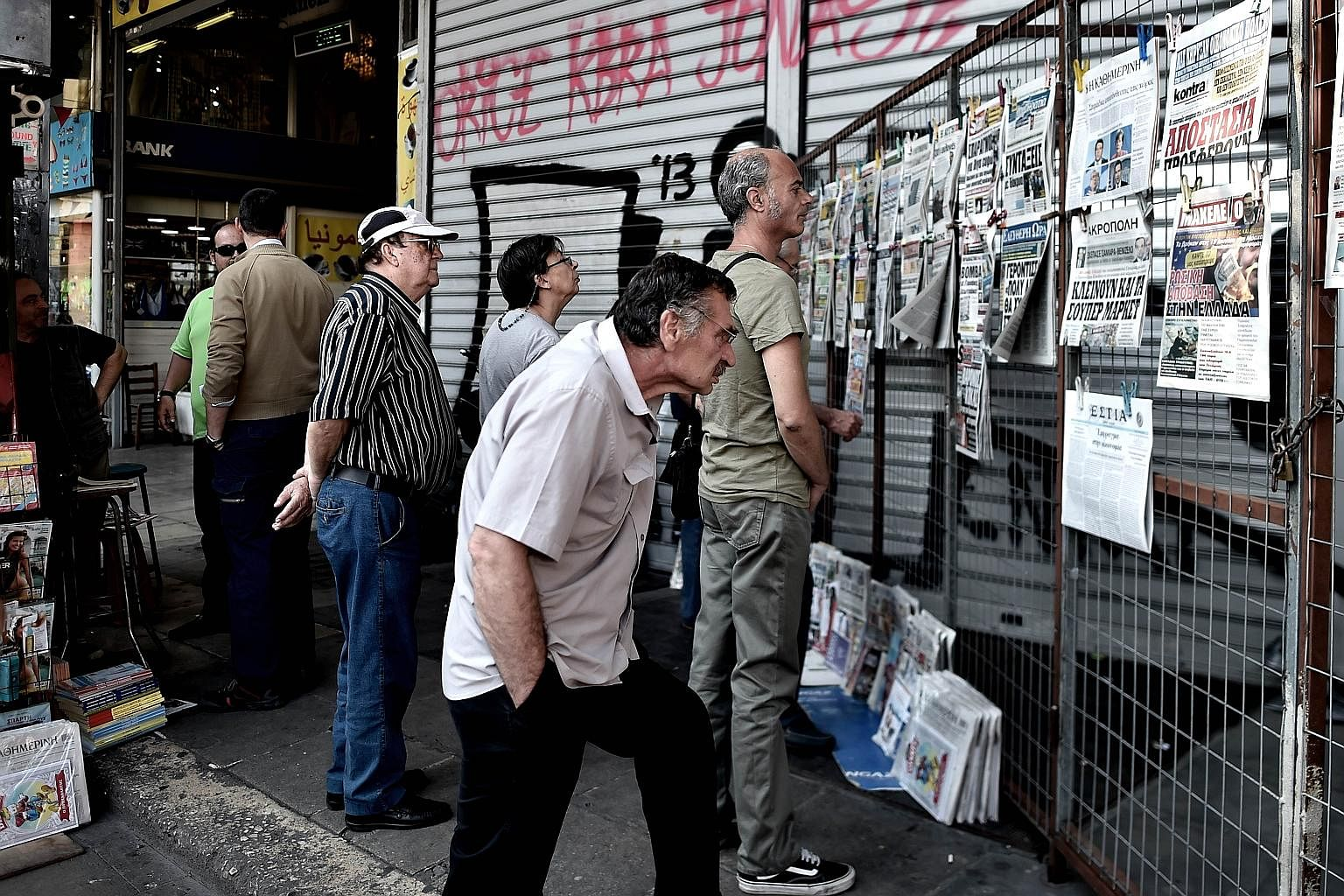 Reactions in Greece to the debt crisis are vastly contrasting. On one of its remote islands, the issue is barely mentioned, unlike in Athens (above), where the discussion never strays far from the crisis.