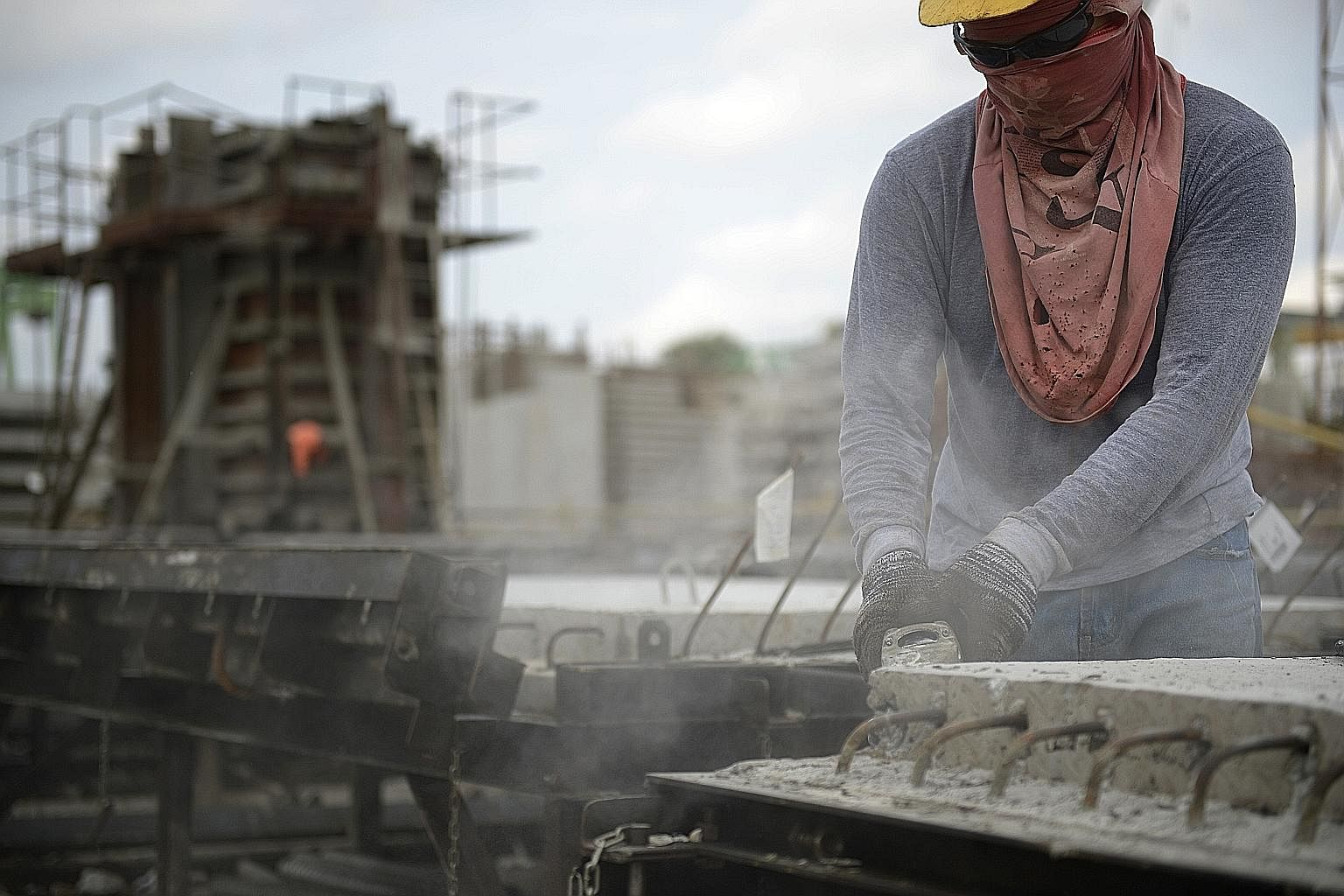 The edges of a wall being smoothened after it is demoulded, to ensure that precast pieces fit well together.