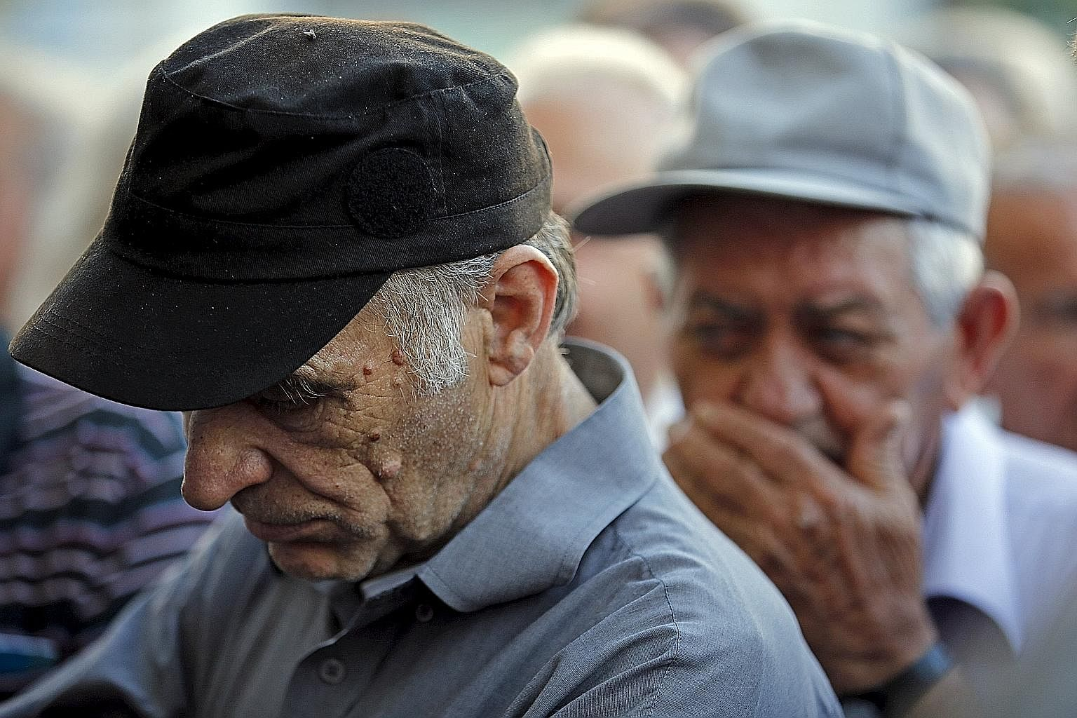 Pensioners waiting outside a bank in Athens on July 9 to receive part of their pensions. The troika's new programme, says the writer, makes no sense either for Greece or its creditors.