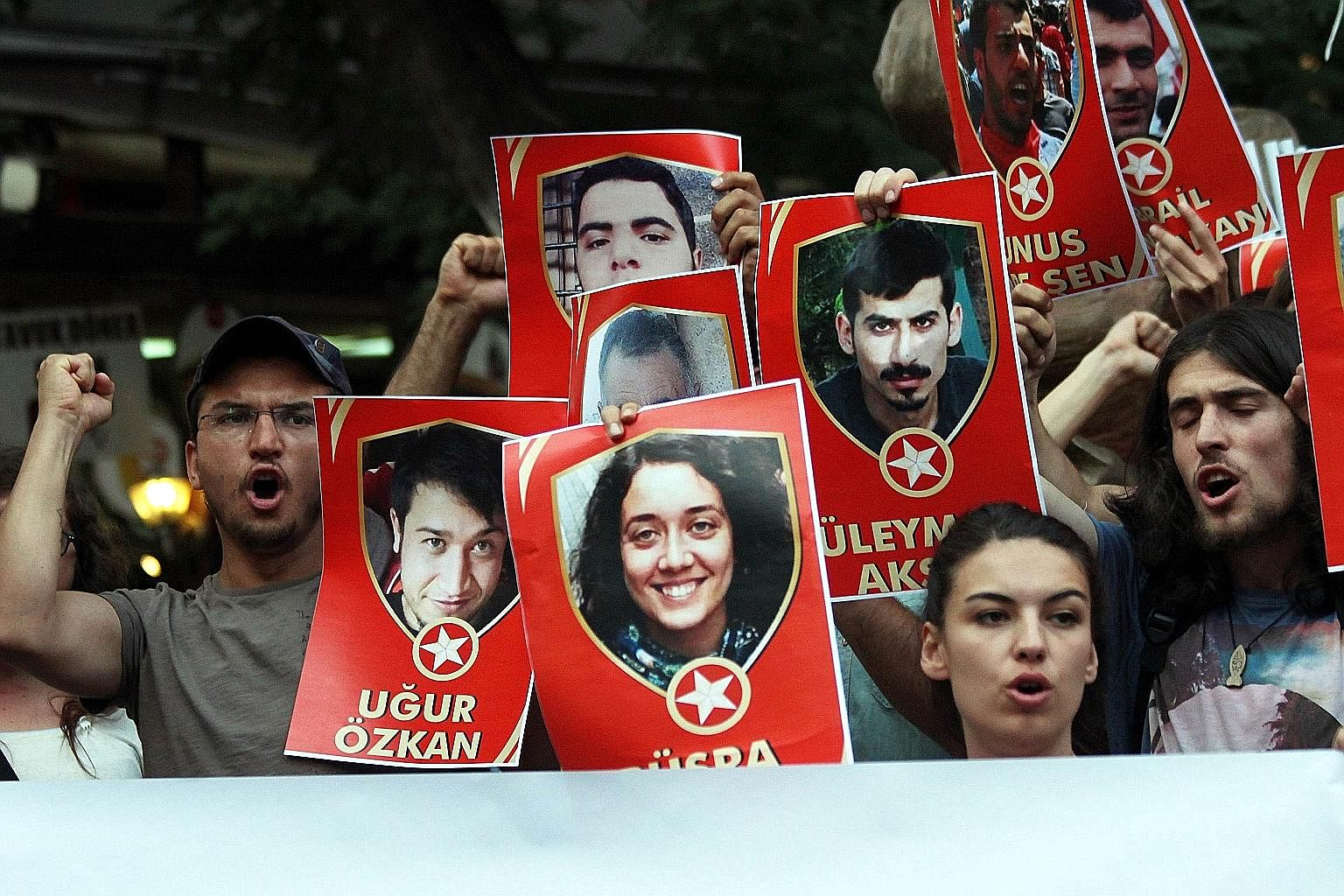 Demonstrators in Ankara displaying pictures of terror victims on Monday as they chanted slogans denouncing a suicide bombing in the Turkish border town of Suruc on July 20 that killed 32 people.