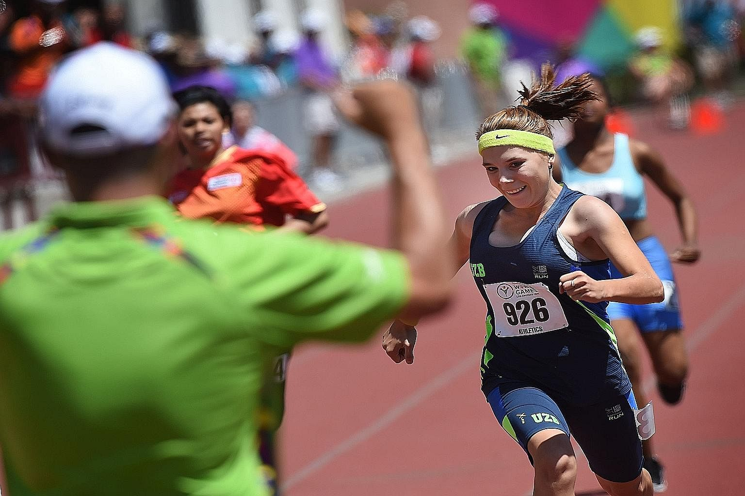 Rufina Shagardanova of Uzbekistan winning her track heat at the 2015 Special Olympics World Games in Los Angeles on Sunday. About 6,500 amateur athletes from 165 countries are taking part in this year's Games. The competition, started in 1968, has gr