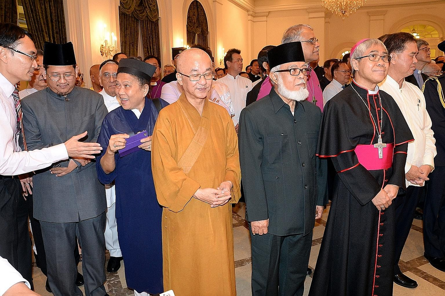 Leaders of the main faiths in Singapore, including (second from left) Mufti Mohd Fatris Bakaram; a representative from the Taoist faith; Venerable Seck Kwang Phing; former Mufti Shaikh Syed Isa; Archbishop William Goh from the Catholic Church; and Mr