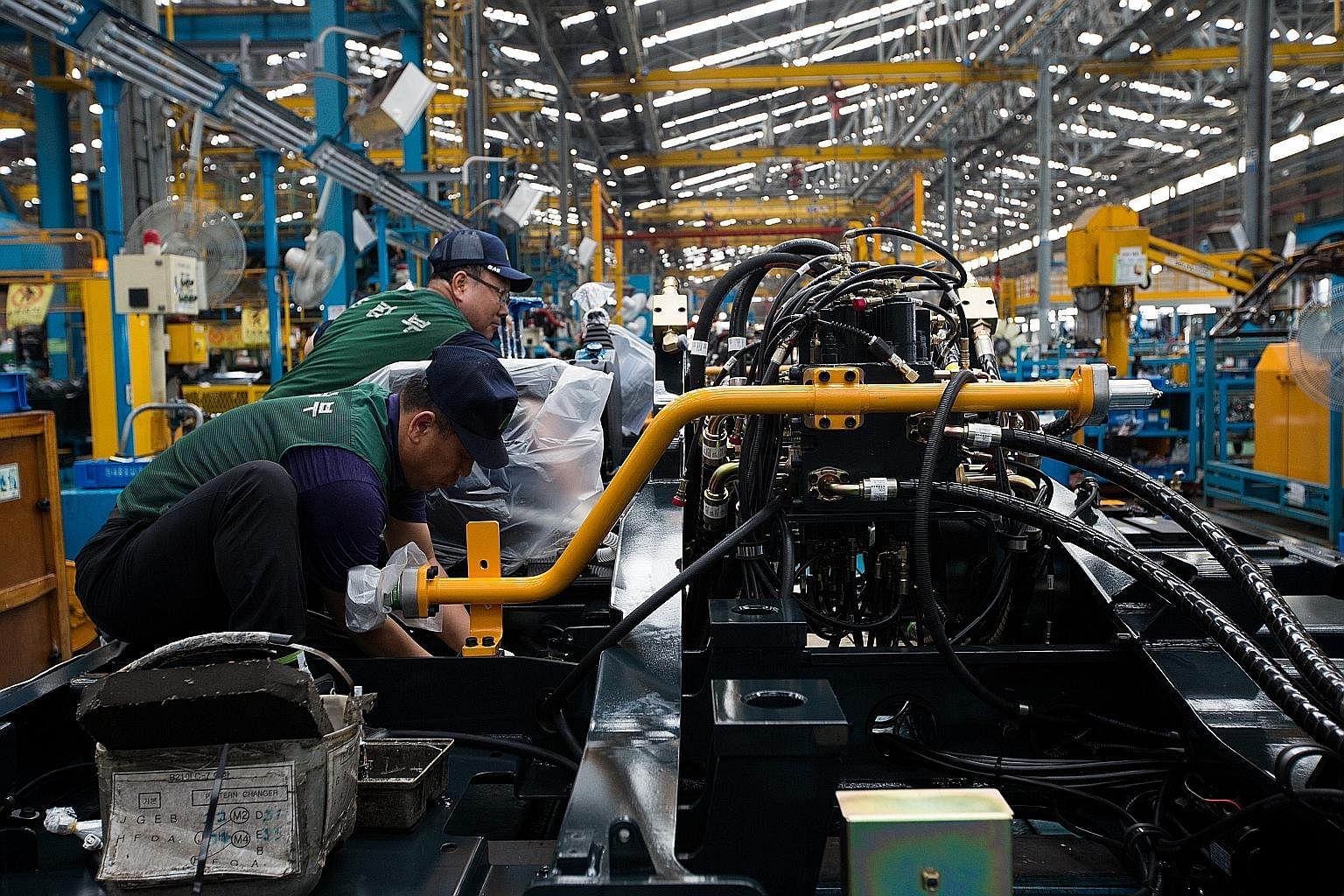 An excavator production line at Hyundai Heavy Industries' plant in Ulsan, South Korea. After decades of robust growth, global productivity flatlined in the 1970s and 1980s, only to surge ahead again in the 1990s and early 2000s. But for the past deca