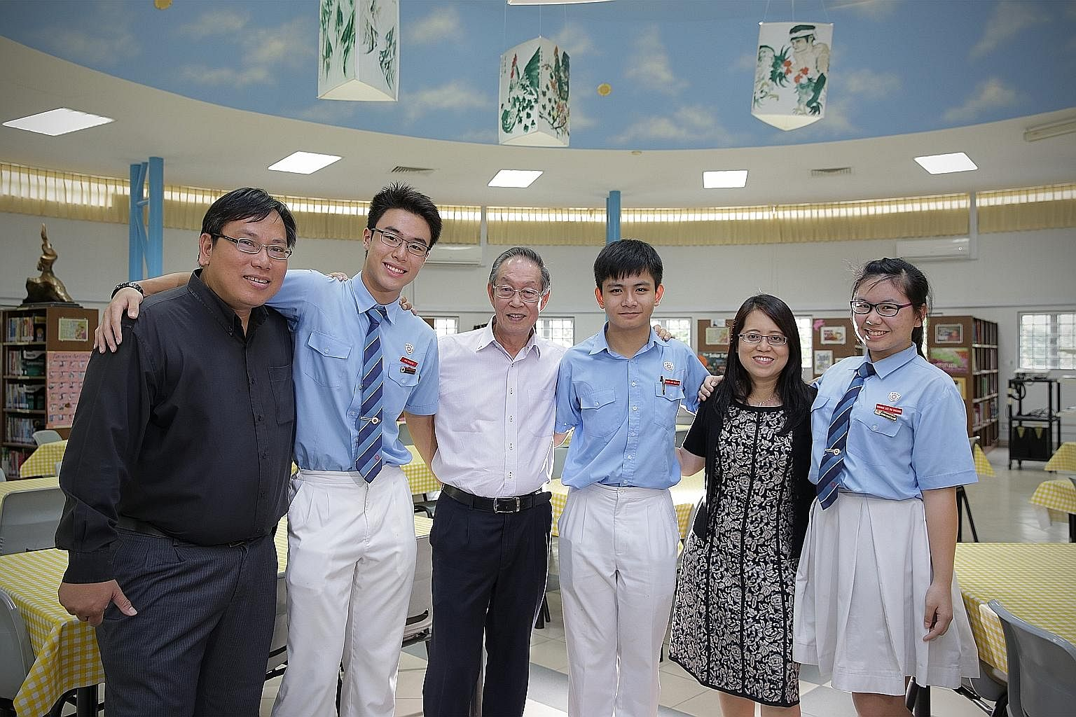 Former student Philip Wu benefited from his school teachers, including Mr Lau Cheong Wong. He now gives back and opens his firm to his juniors for holiday internships. (From left) Mr Wu, student Ong Qing Zhe, Mr Lau, student Vincent Liew, principal W
