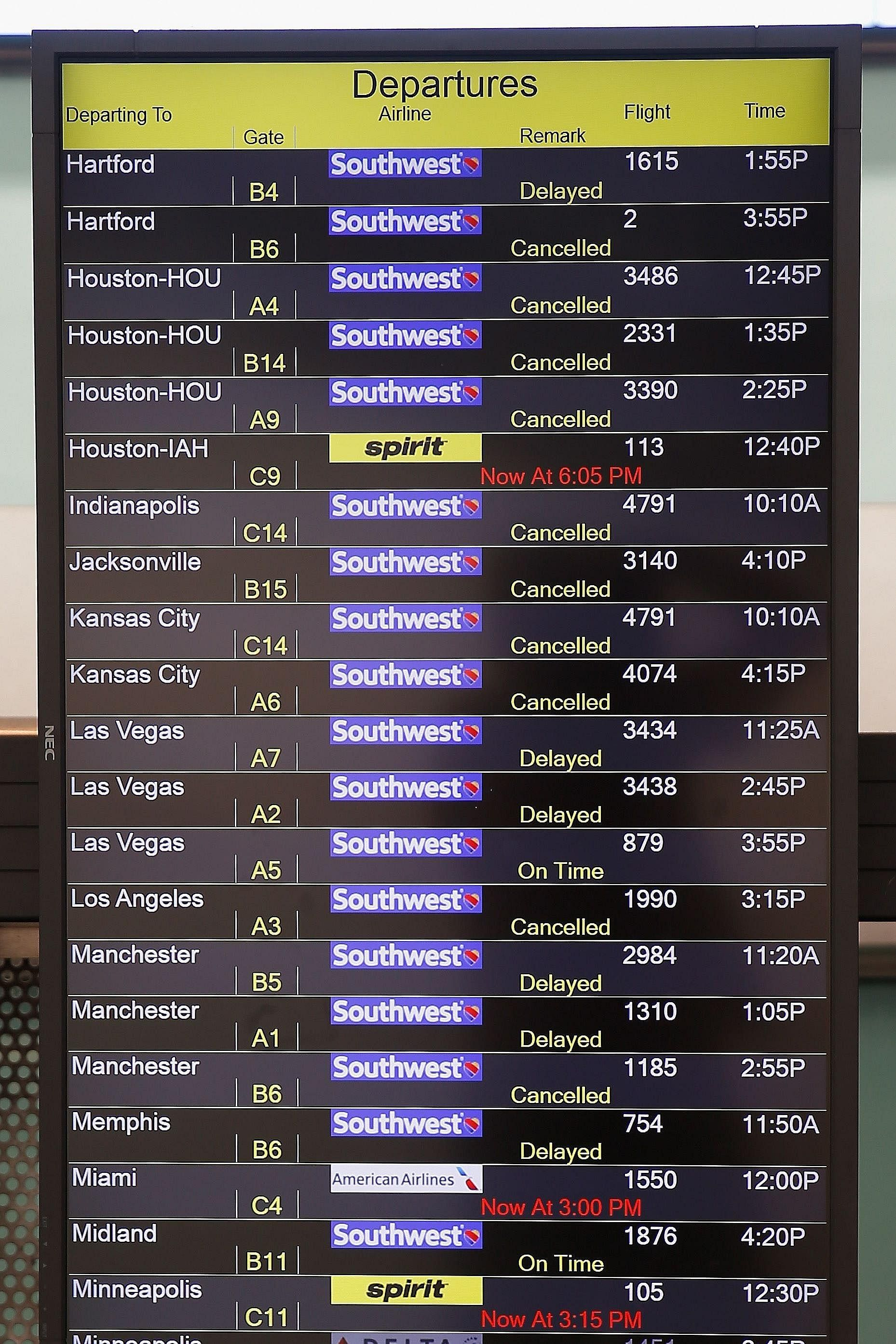 A board at the Baltimore-Washington International Thurgood Marshall Airport displays flights which had been delayed or cancelled.
