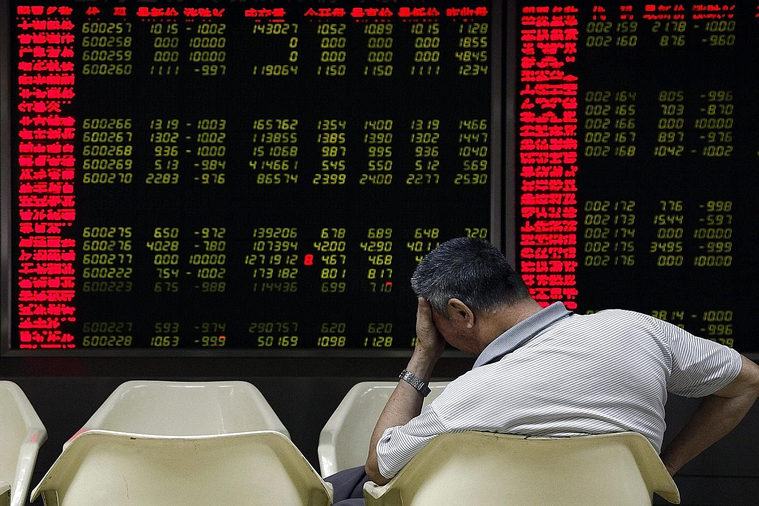 A board showing stock prices at a securities brokerage house in Beijing on Monday. Rather than a financial and economic meltdown, China is experiencing an overdue correction in its equity market.