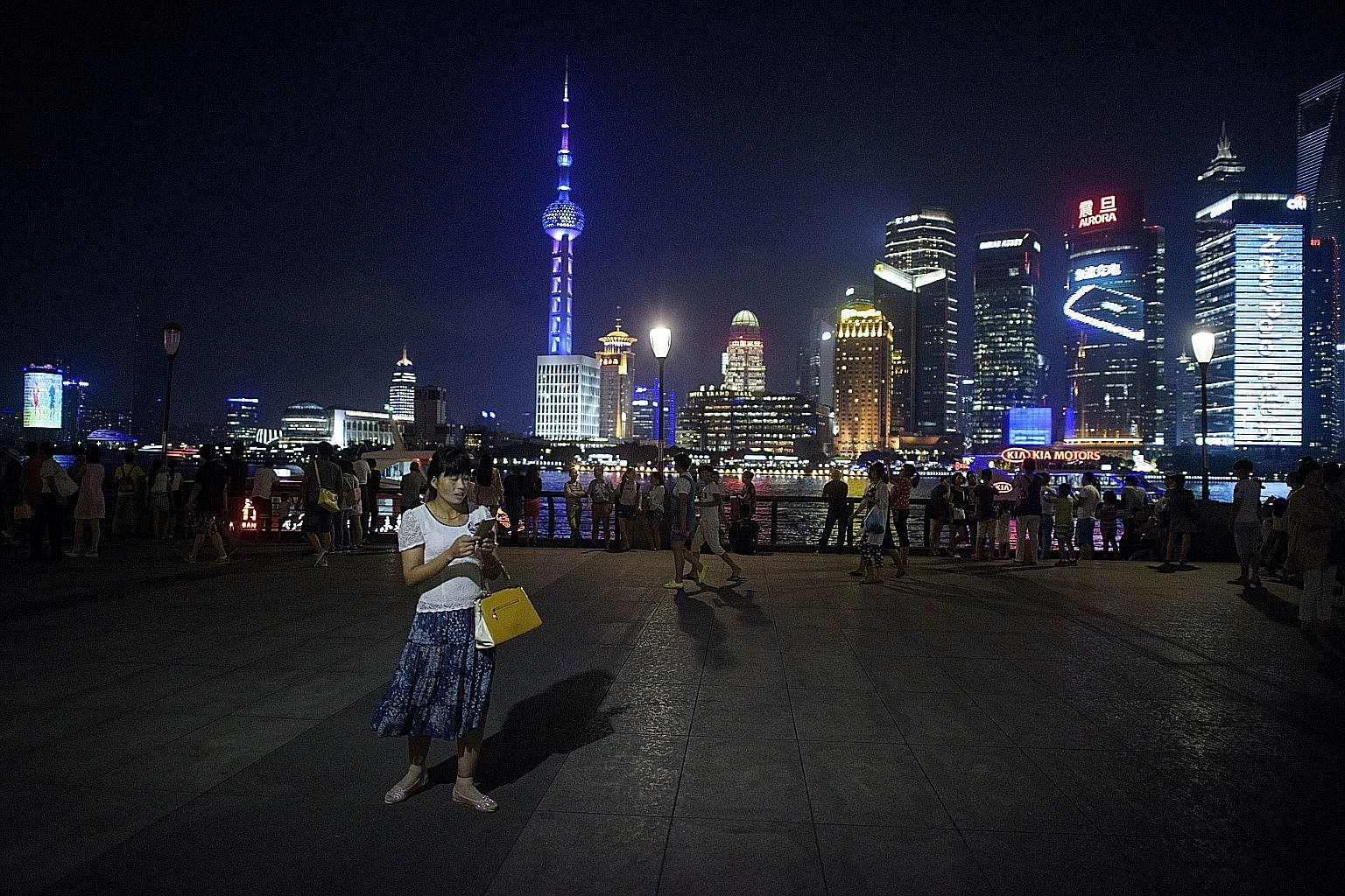 Shanghai's historic Bund. At the inaugural World Huaqiao Huaren Businessmen and Industrialists Conference in July, Chinese Premier Li Keqiang appealed to overseas Chinese businessmen to put China first.