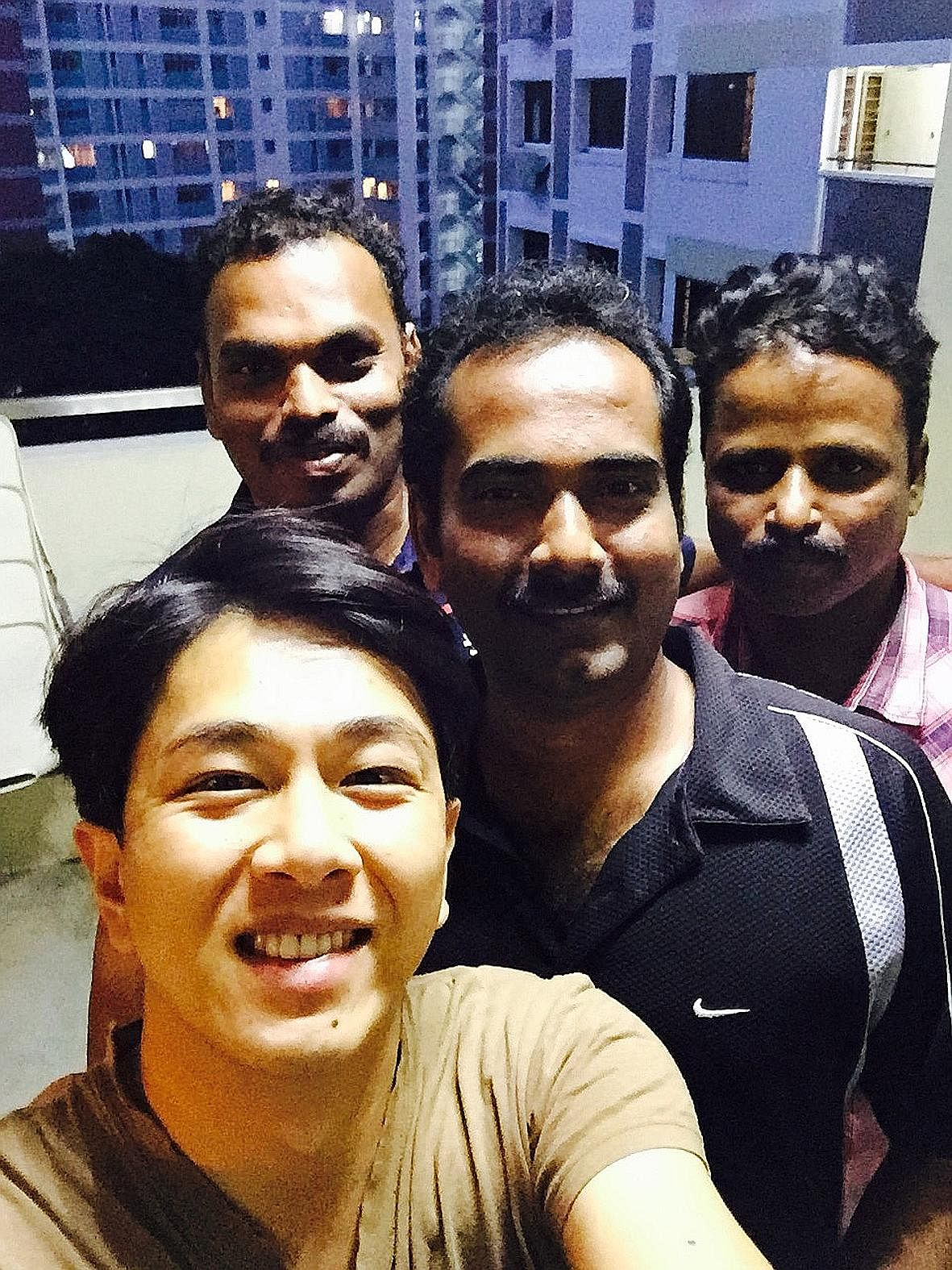 Mr Sugie Phua took a photo with the three men who returned his wallet.
