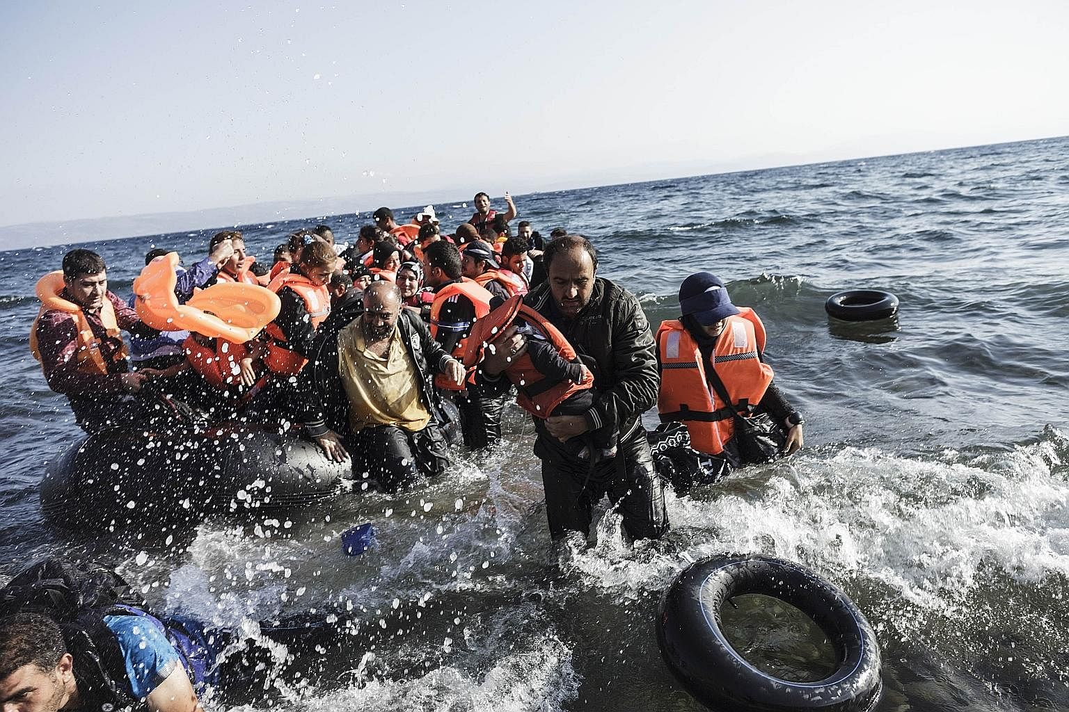 Syrian refugees arriving on the shores of the Greek island Lesbos in an inflatable boat from Turkey last month.