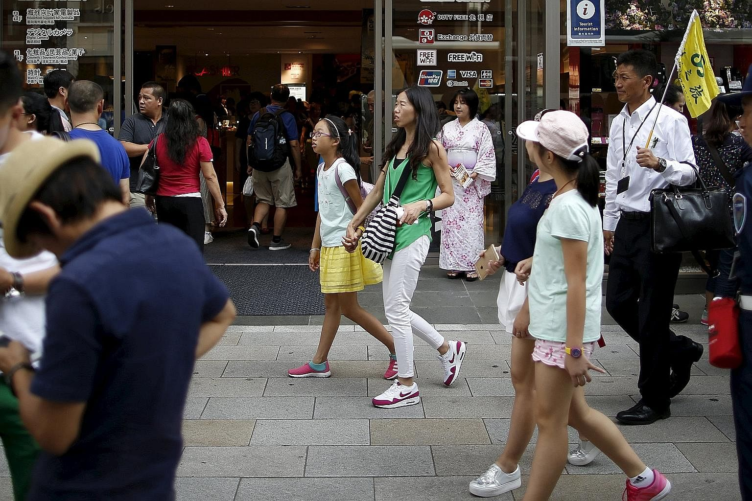 Chinese tourists in Tokyo's Ginza shopping and amusement district last month. Japan is among the most popular destinations for travellers from China. July and August are traditionally the peak summer vacation months.