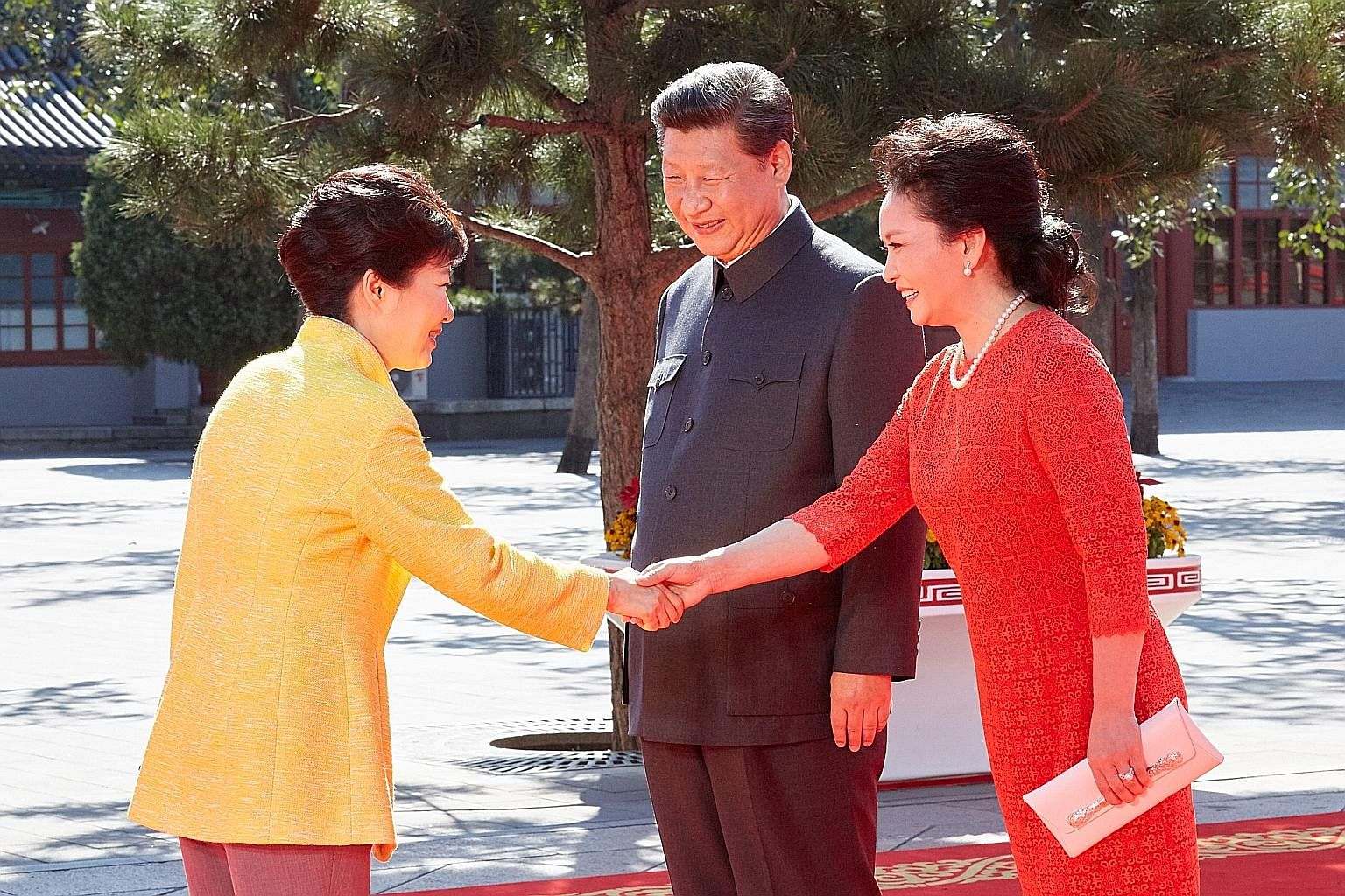Ms Park Geun Hye (left) being welcomed by Mr Xi Jinping and his wife Peng Liyuan on Sept 3 at Tiananmen Square, where a military parade was held to commemorate the end of World War II.