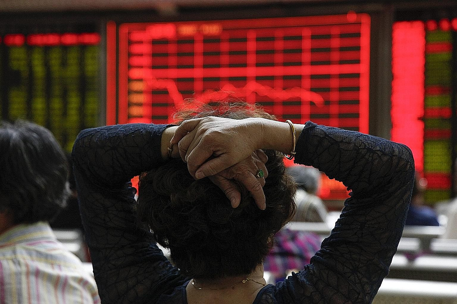 An investor monitoring stock market data on an electronic board at a securities brokerage house in Beijing earlier this month.