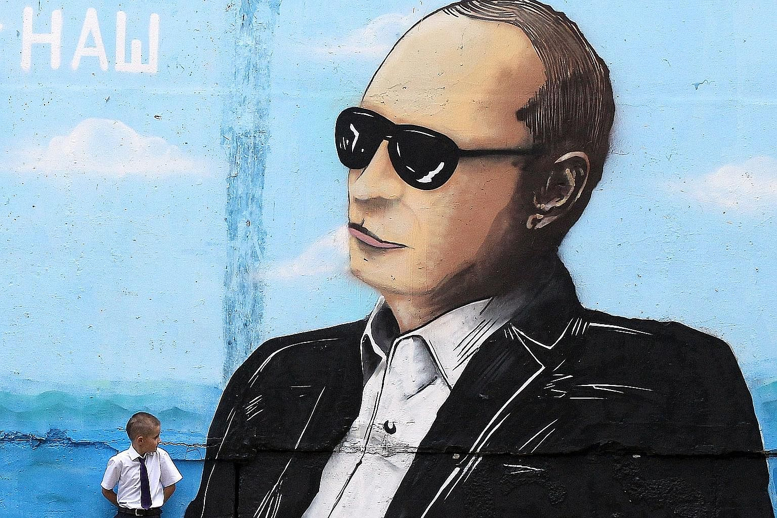 Russian leader Vladimir Putin's image on a wall in the Crimean city of Simferopol. A rapprochement on Syria would risk undermining the West's Ukraine-related sanctions, and provide Mr Putin with tacit recognition of Russia's annexation of Crimea and