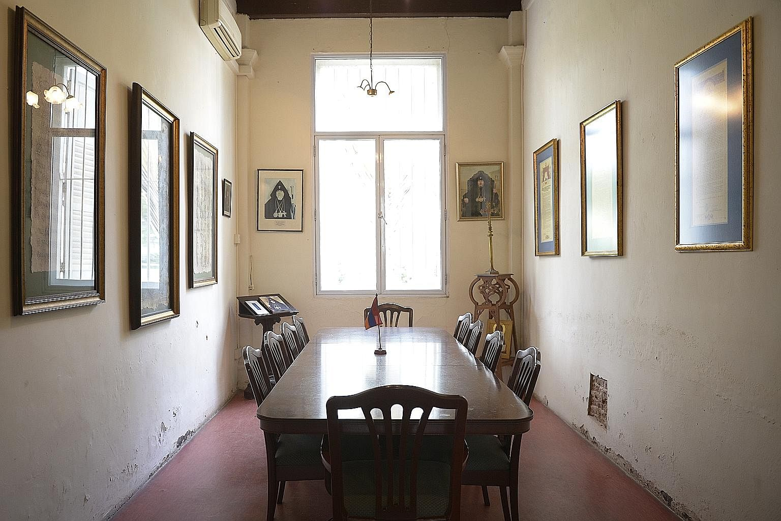 A meeting room on the ground floor of the parsonage in Hill Street. On its walls are portraits of leaders in the Armenian faith, and pictures from the Armenians' culture and history.
