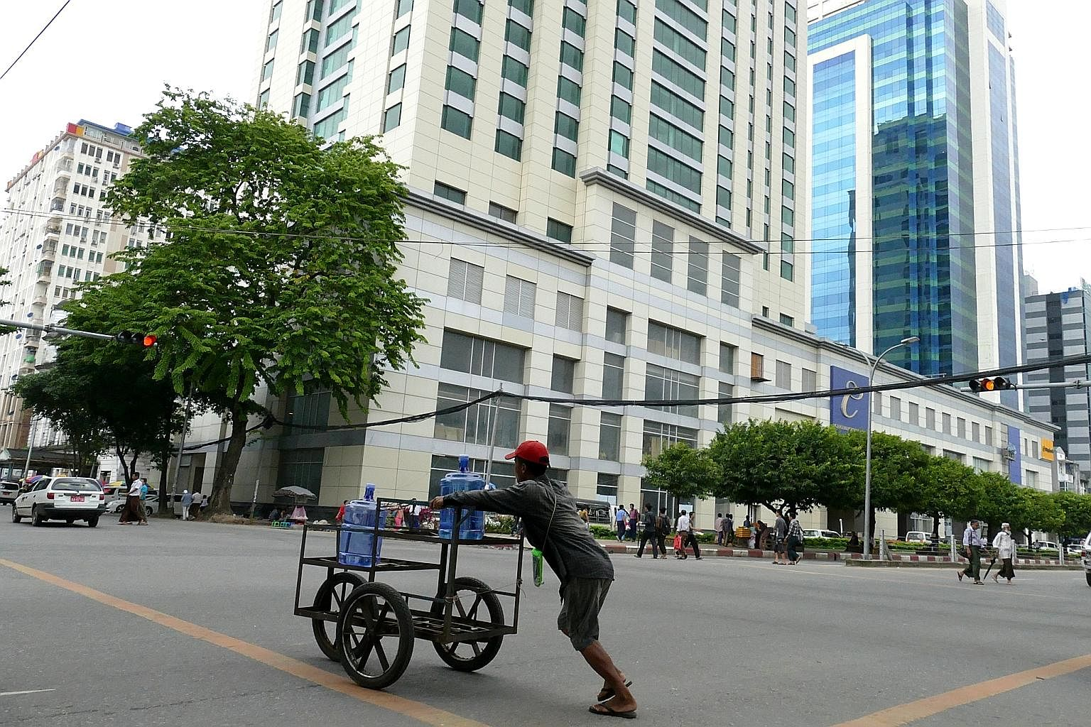 New buildings and hotels are mushrooming throughout the city in an ongoing construction boom. Mr Maung Htwe, 47, who sells used heavy tools, from hooks to wrenches to hammers and saws, has been at the corner of 21st Street and Anawratha for 29 years,