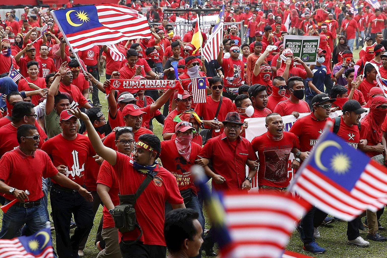 "Malaysians gathering for the ""red shirt"" rally in downtown Kuala Lumpur on Sept 16 to galvanise Malays against a supposed plot by the Chinese to usurp Malay political power."