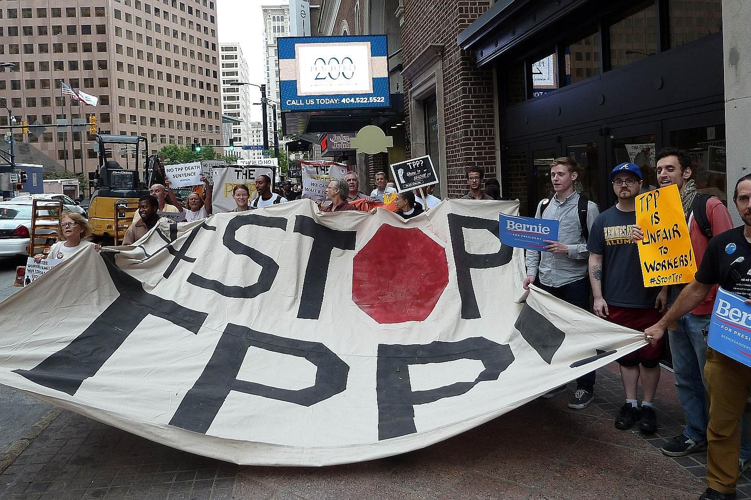 Protesters calling for the rejection of the TPP trade deal in Atlanta last week. Provisions in the TPP make it hard for governments to conduct their basic functions - protecting their citizens' health and safety, ensuring economic stability and safeg