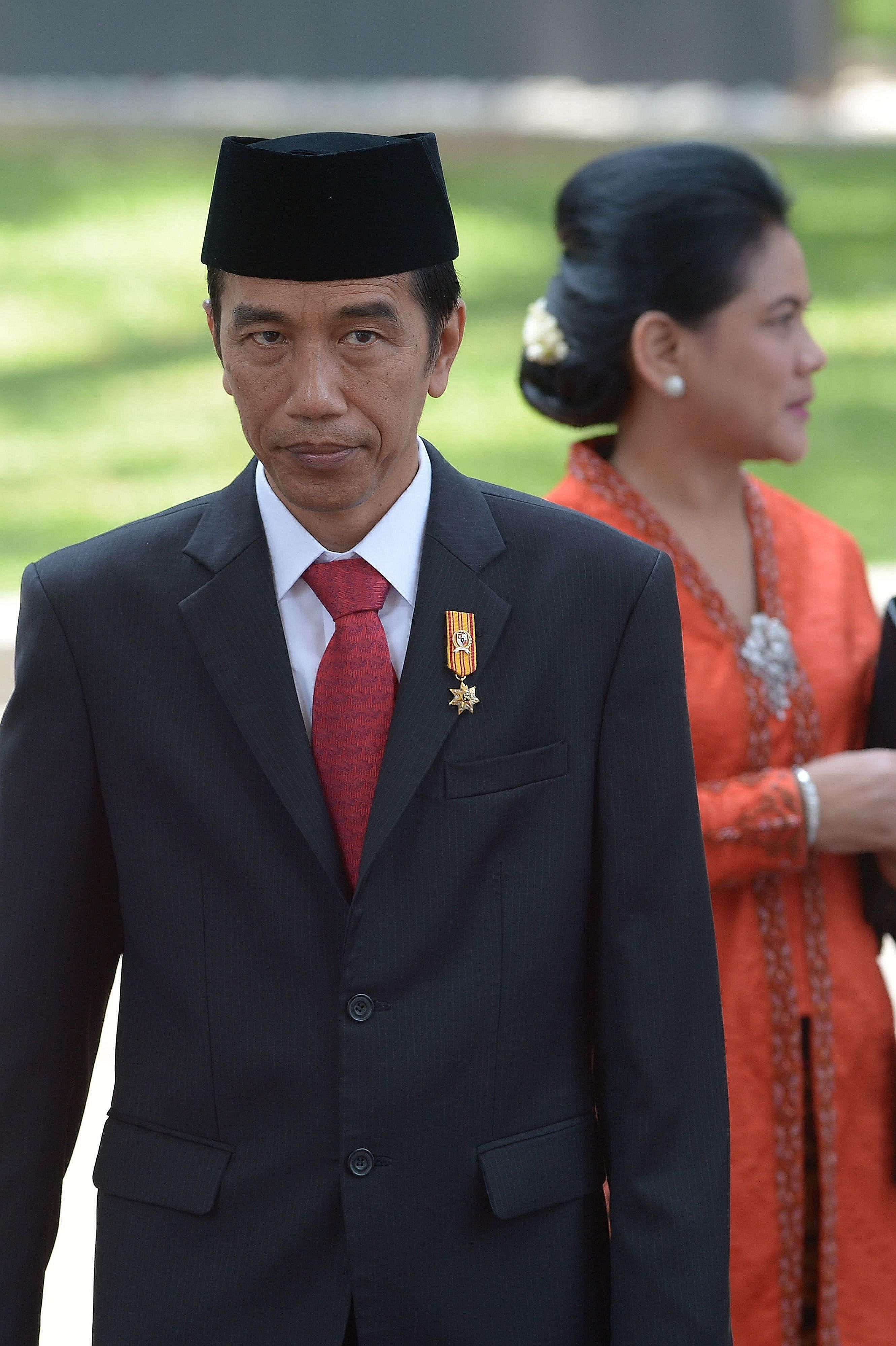 Indonesian President Joko Widodo with his wife Iriana Widodo at the presidential palace in Jakarta. President Joko's humility and approachability have endeared him to Indonesians. He embodies the way in which a people's democracy can unite to fight t