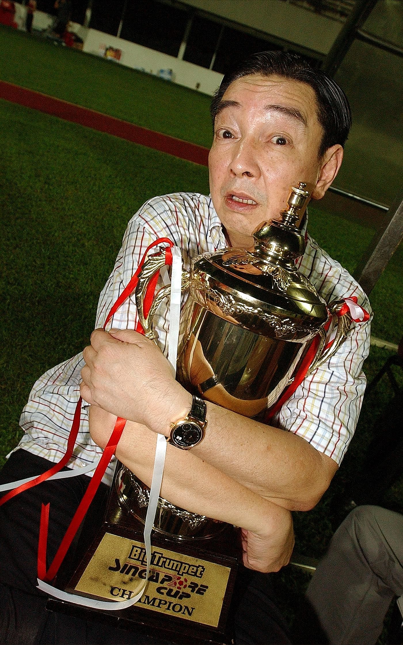 Teo Hock Seng back in 2004 with the Singapore Cup trophy. In 15 years as the Stags' chairman, he took pleasure in winning silverware and developing young players rather than aiming for lucrative returns.