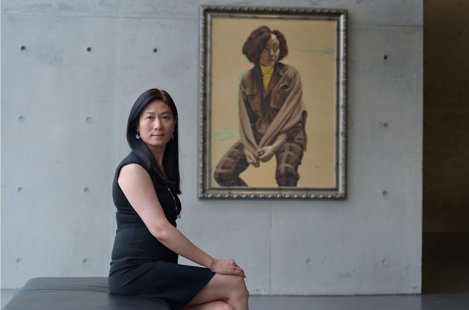 Ms Wang Wei, co-founder of the Long Museum in Shanghai, with Beige Portrait by artist Yu Hong.