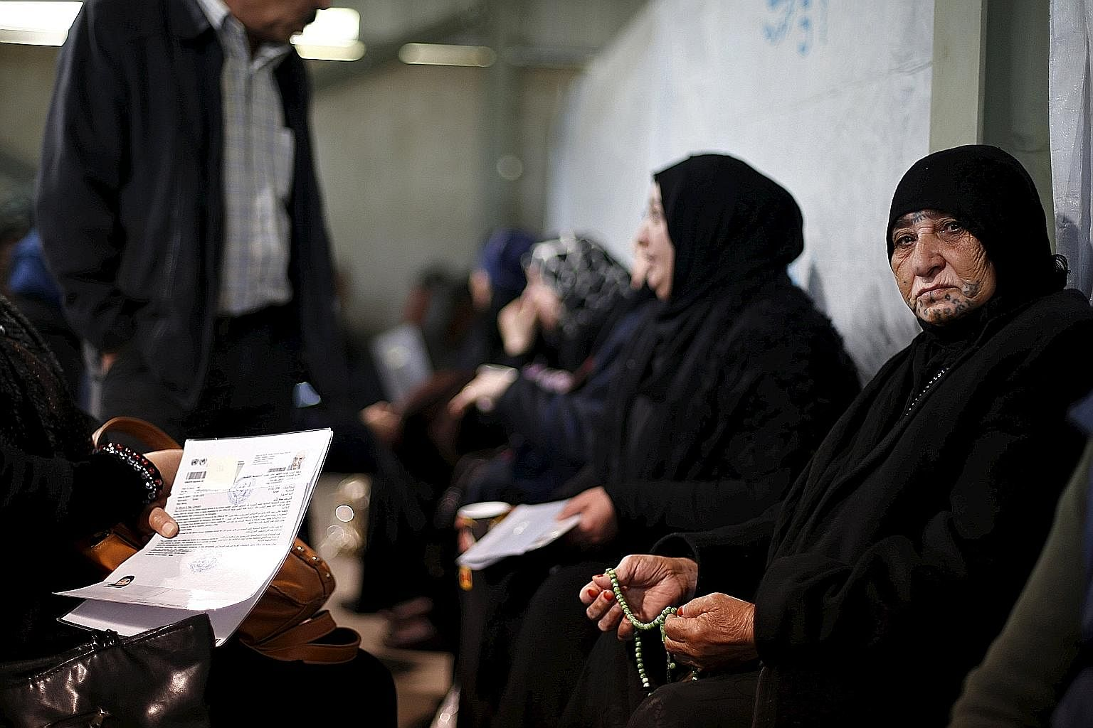 Syrian refugees waiting to register at the office of the UN High Commissioner for Refugees in Amman, Jordan, last week.