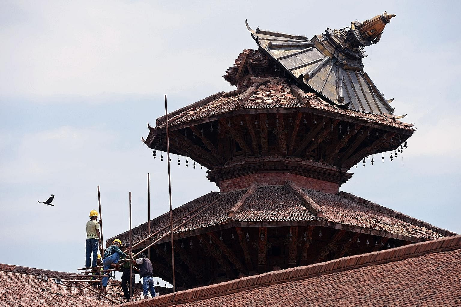 Workers reinforcing the roof of a temple in historical Durbar Square, in Nepal, which had collapsed, following an earthquake in April.