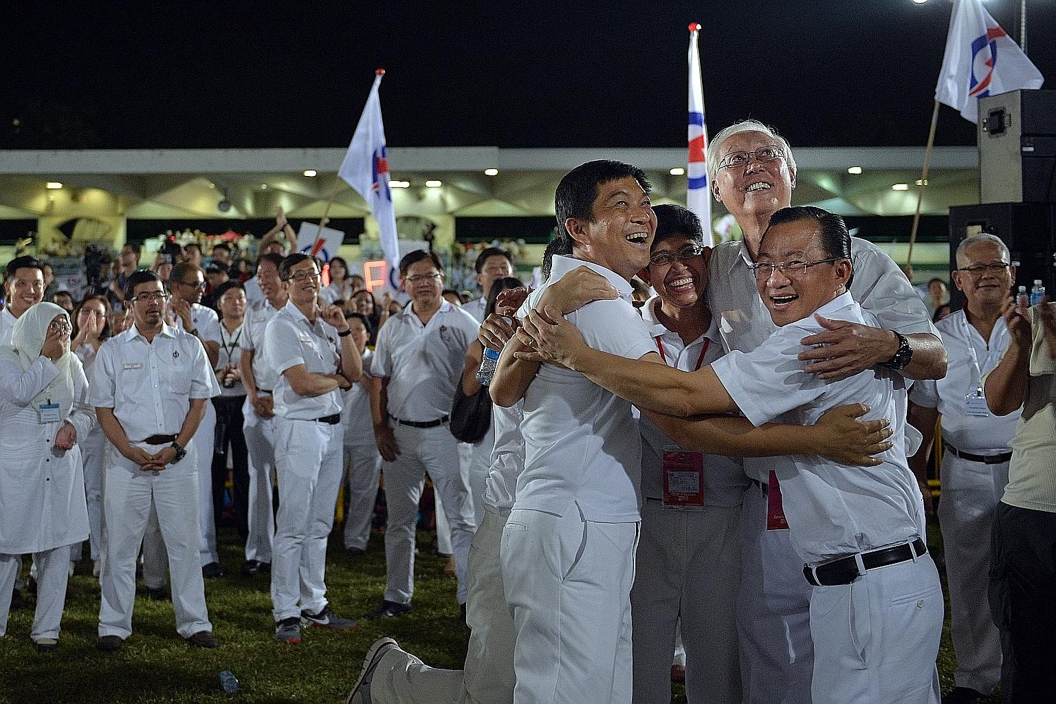 6 VICTORY HUG (far left) The People's Action Party's Marine Parade GRC team - (from left) Mr Tan Chuan-Jin, Mr Edwin Tong (hidden), Dr Fatimah Lateef, Mr Goh Chok Tong and Mr Seah Kian Peng - celebrating their win in the Sept 11 General Election afte