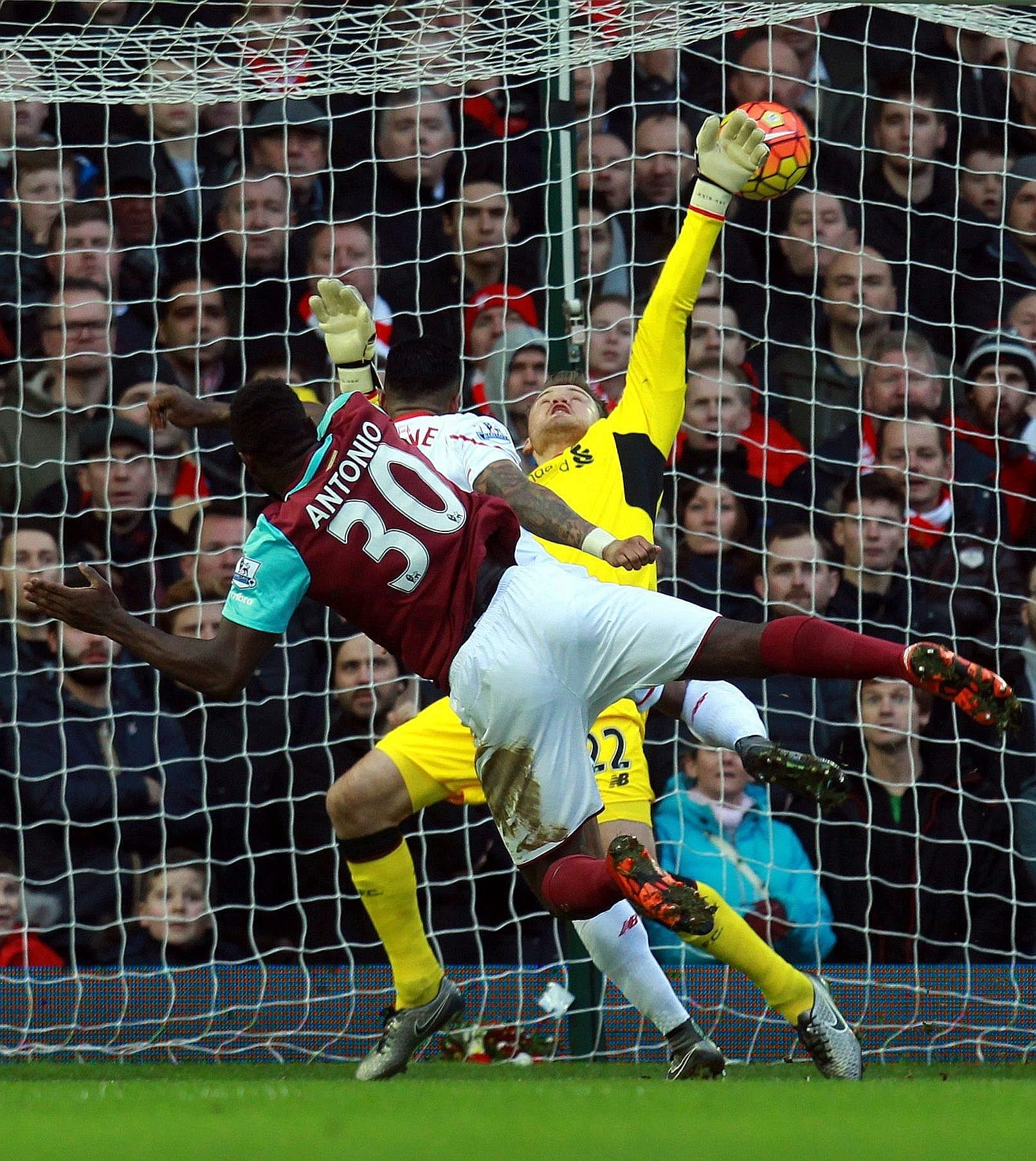 West Ham's Michail Antonio heading past Liverpool goalkeeper Simon Mignolet to open the scoring for the Hammers. Andy Carroll netted a second for the hosts to complete a league double over the Reds.