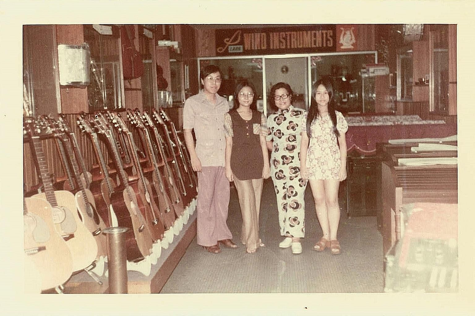(From left) City Music founder Willy Hoe, his wife, Shirley, Mr Hoe's mother and an unidentified woman at their original store at Bras Basah.