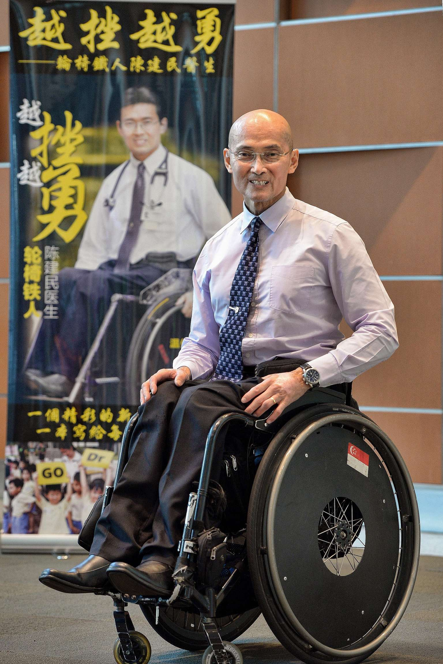 Dr Tan in front of a banner for his new Mandarin book More Challenges, More Vigour. Proceeds from the sales will go to charity.