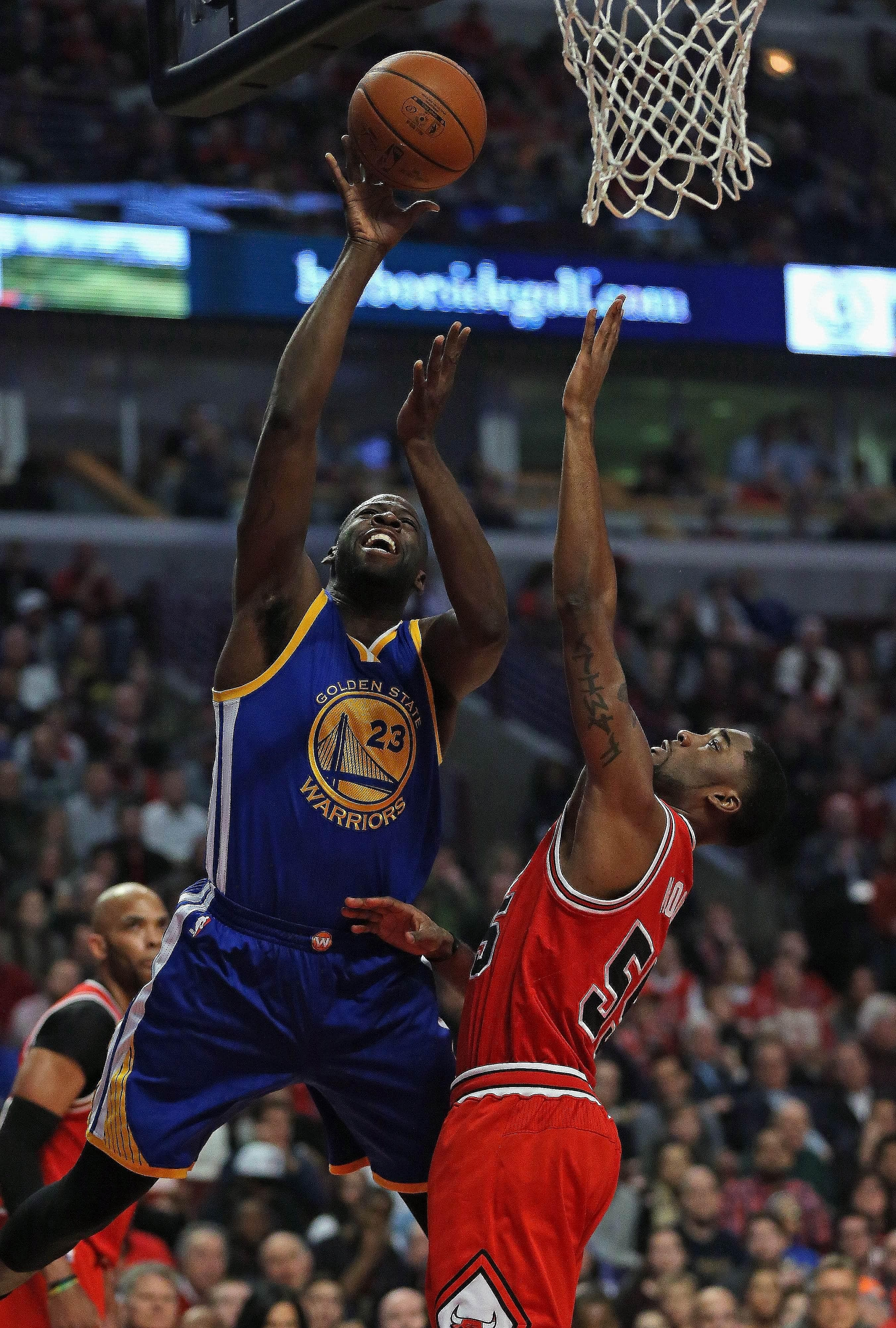 Golden State's Draymond Green (left) putting up a shot over Chicago's E'Twaun Moore at the United Centre. The Warriors defeated the Bulls 125-94.
