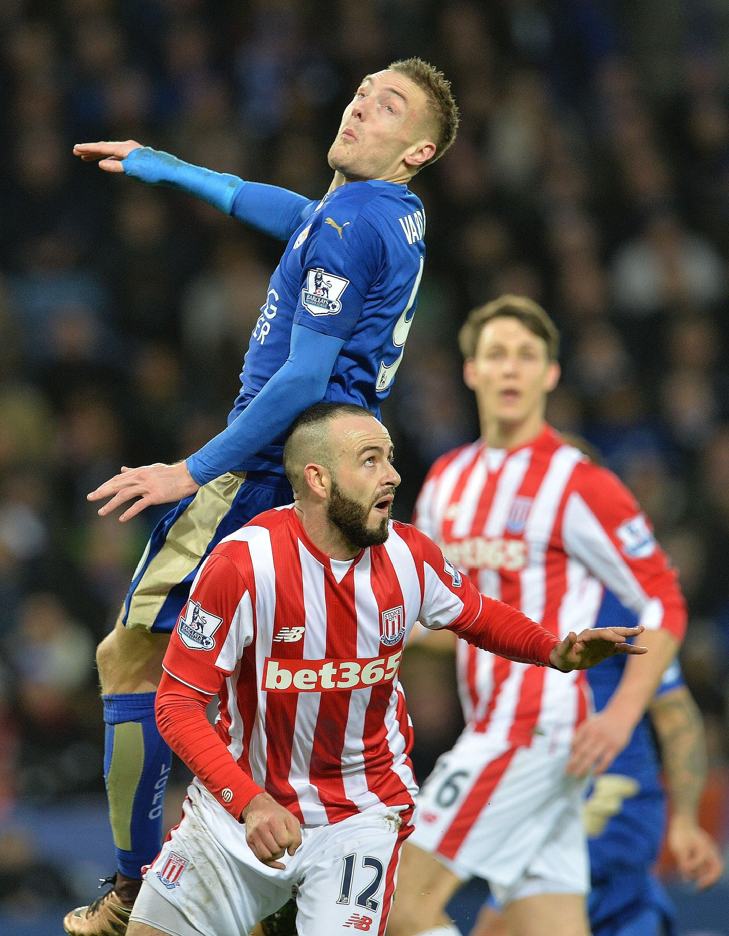 Leicester City's Jamie Vardy (above) attempting to beat Stoke City's Marc Wilson to the ball at the King Power Stadium. The Foxes won the match 3-0, with Vardy scoring the second goal.