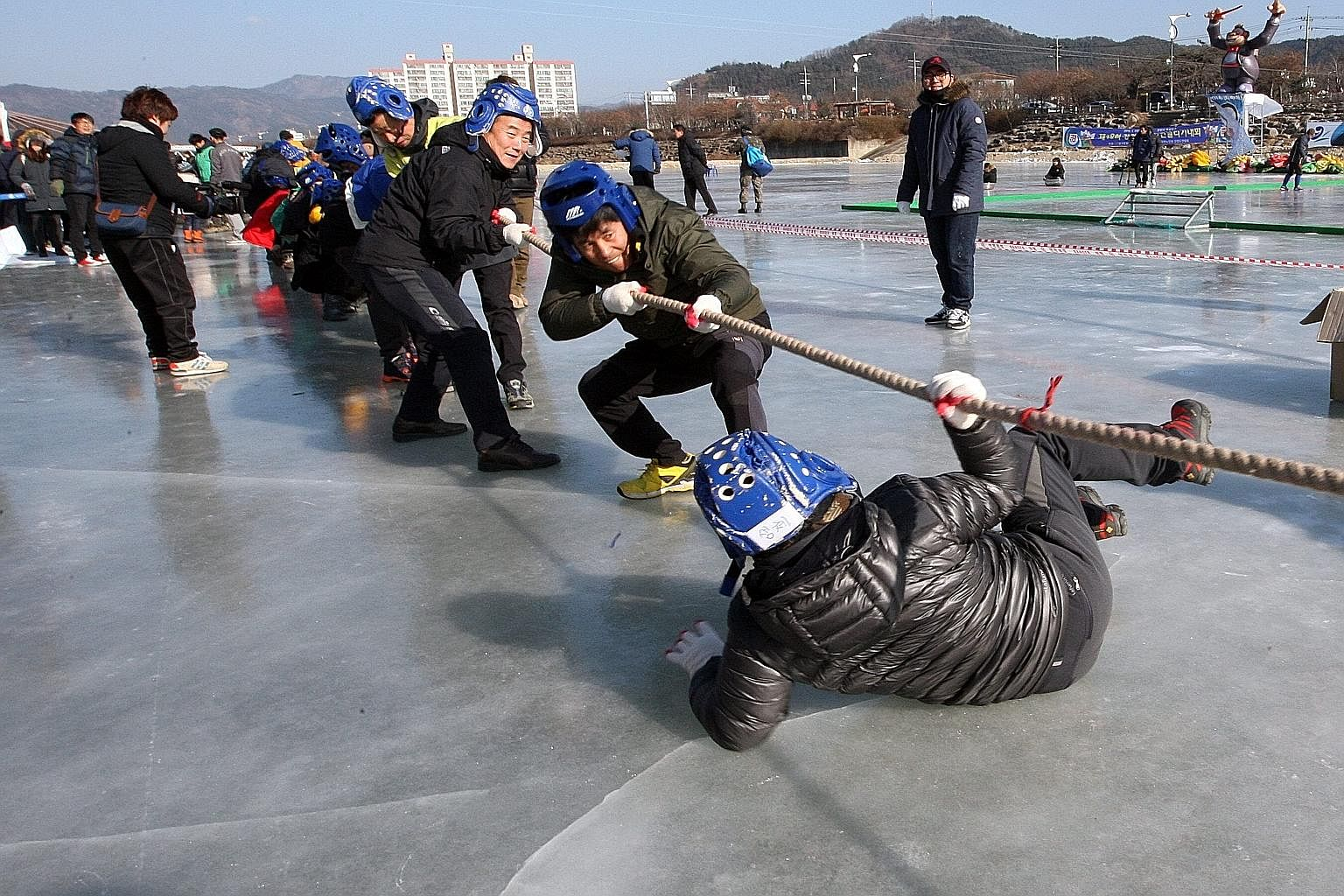 South Koreans enjoying a tug-of-war at a winter festival in Gangwon province over the weekend as the country shivered to a cold wave with temperatures dropping to as low as -20 deg C.