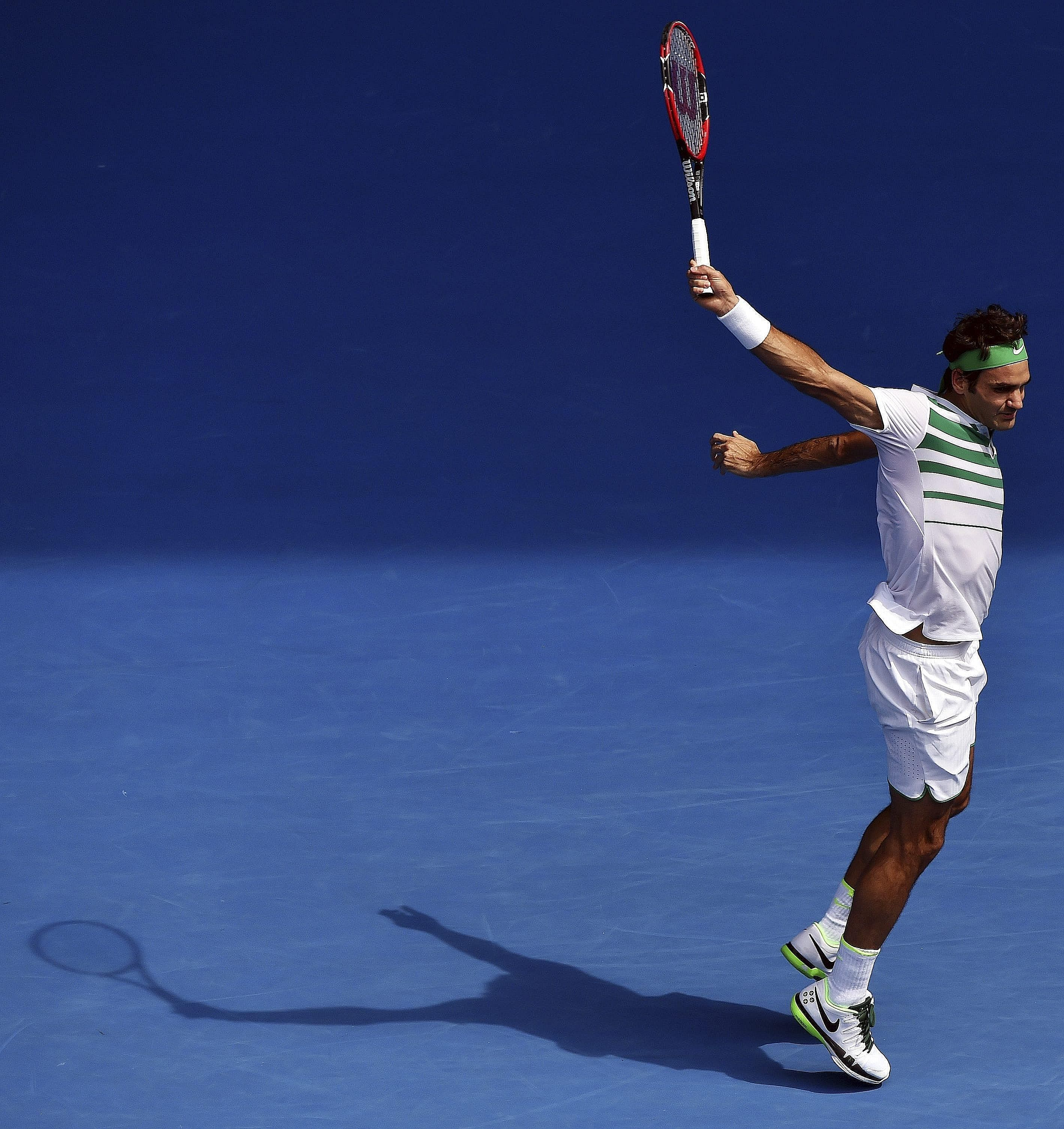 Roger Federer combines poise, balance and grace in his follow-through to a backhand in his Australian Open quarter-final against Tomas Berdych of the Czech Republic at the Australian Open yesterday. Federer dropped his opening service game but won 7-