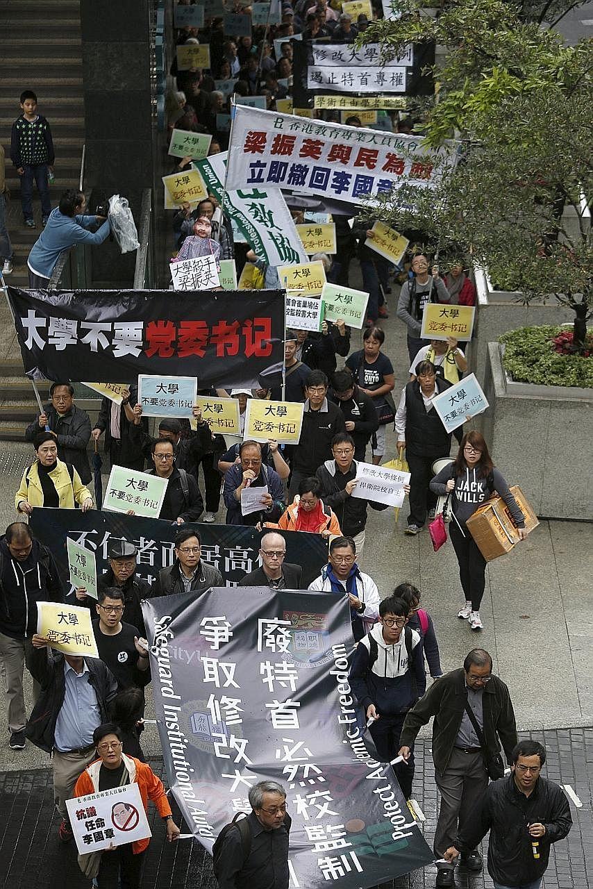 Protesters marching against the appointment of a pro-Beijing professor as the chairman of the governing council of the University of Hong Kong. The protest took place on Jan 3 this year.