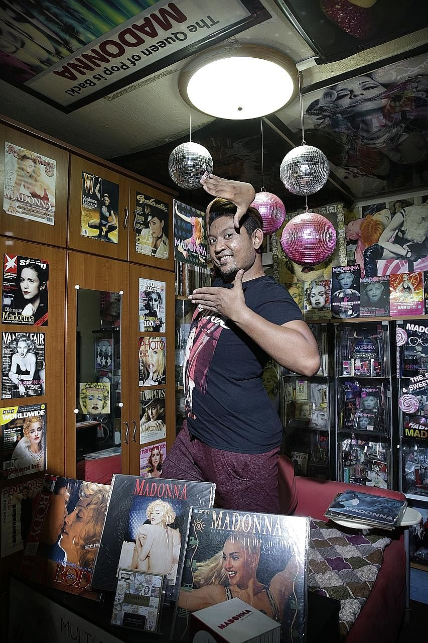 Customer service officer Abdul Rahman Selamat says listening to Madonna helps him to relieve stress. Food services executive Panda Tan (right) and his magazine collection of more than 2,000 copies. He tries to get every international cover of every p