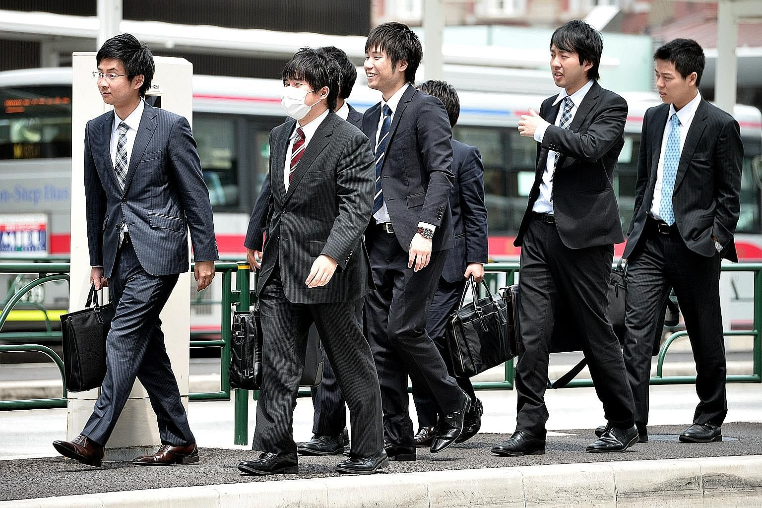 Japanese salarymen on their way to work in Tokyo. While Japan has achieved many things, including being the first Asian nation to attain First World status, its people remain kind and gracious. Its case shows that being competitive is not incompatibl