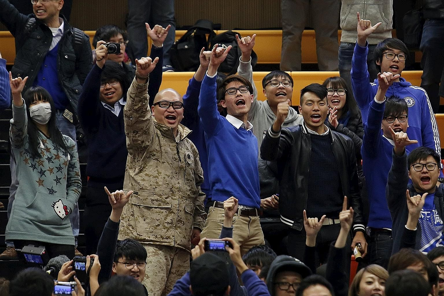 Supporters of Mr Leung, a candidate from Hong Kong Indigenous, chanting slogans during the announcement of the final results of a by-election in Hong Kong yesterday. Mr Leung placed third among seven contenders.