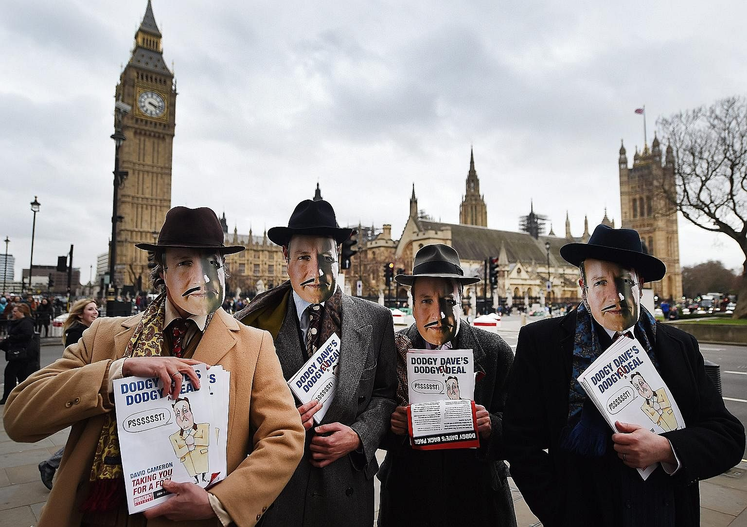 Anti-European Union demonstrators Grassroots Out dressed as British Prime Minister David Cameron protesting outside Parliament in London, Britain, on Feb 19. Mr Cameron has promised a new law putting beyond doubt the sovereignty of the UK legislature