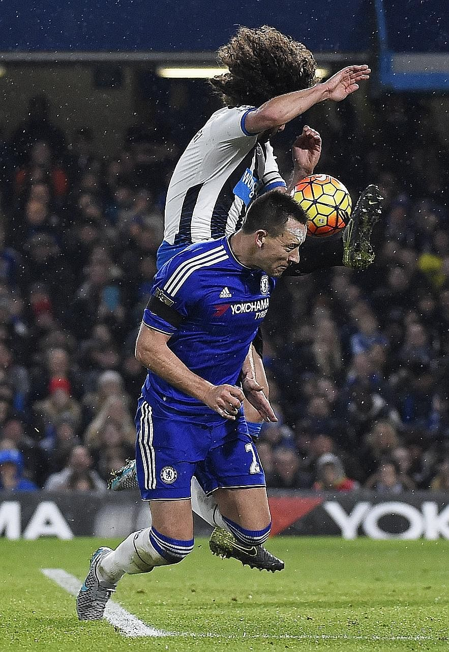 Chelsea skipper John Terry in action against Newcastle United's airborne Fabricio Coloccini in their Premier League encounter on Feb 13. The Blues' skipper is injured but Diego Costa should be fit to play against Paris Saint-Germain in the Champions