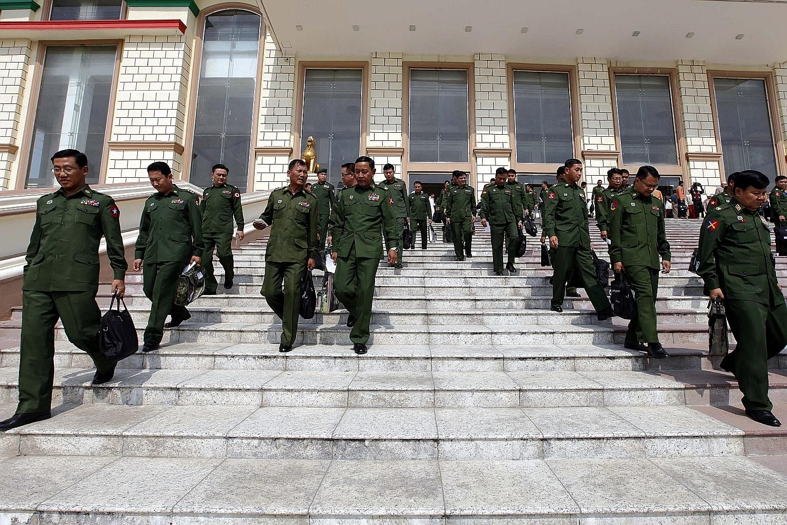 Military representatives leaving after a regular session of Parliament in Naypyitaw on March 1. Recent developments have suggested that the present military leadership is intent on sustaining its influence on the country's politics at least for the n