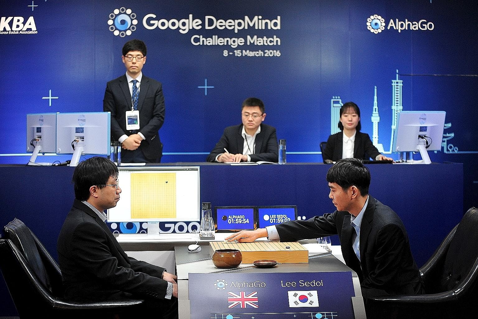 Mr Lee, the world's top Go player, taking on the AlphaGo program as Google DeepMind's lead programmer Aja Huang (far left) looked on during the Google DeepMind Challenge Match in Seoul, South Korea, earlier this month.