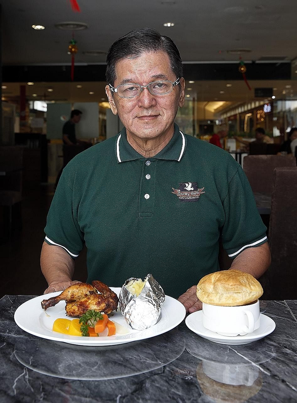 Country Manna's Francis Low with the restaurant's Spring Chicken and Country- style chicken soup.