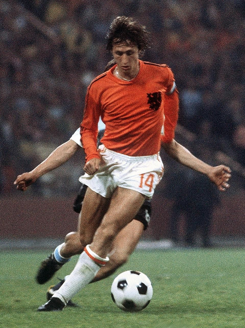 A 1974 photo showing the late Dutch forward Johan Cruyff controlling the ball under pressure from a West German player during the World Cup final in Munich which was won by the host nation.